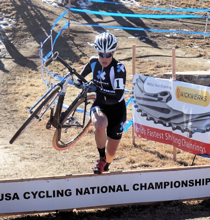 Katie Compton over the barriers at CX Nats 2014